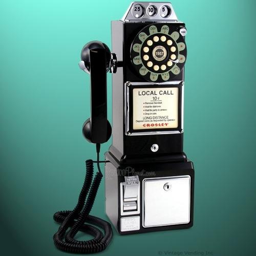 Teléfono de monedas antiguo